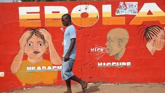 Wandgemälde in Monrovia, mit dem Symptome von Ebola dargestellt werden