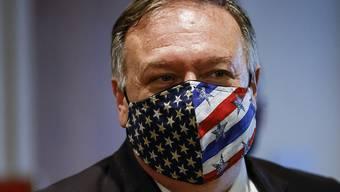 ARCHIV - Mike Pompeo, Außenminister der USA, verlässt ein Treffen des UN-Sicherheitsrates. Die im Alleingang aus dem Atomabkommen mit dem Iran ausgestiegene US-Regierung hält alle UN-Sanktionen gegen die Islamische Republik wieder für gültig. Foto: Mike Segar/Pool Reuters/AP/dpa