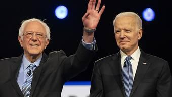 Senator Bernie Sanders (links) hat Joe Biden (rechts) offiziell seine Unterstützung für die Präsidentschaftswahlen in den USA zugesichert. Biden ist der einzige verbleibende Bewerber für das Amt.
