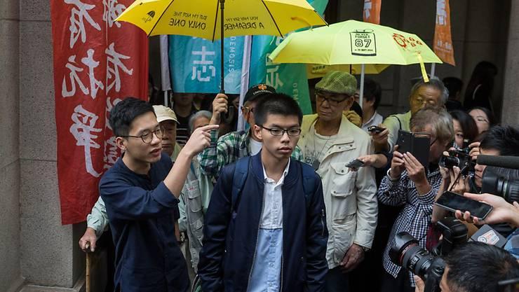 Regenschirm-Protestler Joshua Wong und Nathan Law vor dem Berufungsgericht in Hongkong. Ihre Proteste waren 2014 eine Herausforderung für Chinas kommunistische Führung.