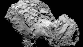 """Die """"Quietsche-Entchen""""-Form des Kometen """"Tschuri"""" entstand offenbar durch das gemächliche Zusammenstossen zweier eisiger Brocken."""