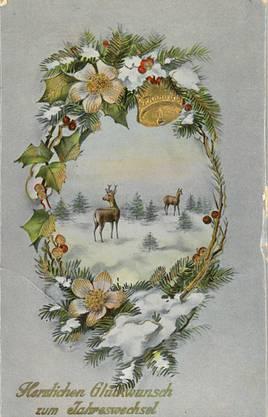 Hirsche in der Winterlandschaft. Eine mit Lack überzogene Neujahrskarte aus dem Jahr 1915.