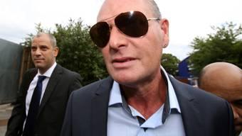 Der frühere britische Fussballspieler Paul Gascoigne (Mitte) ist wegen Rassismus zu einer Geldstrafe verurteilt worden (Archiv)
