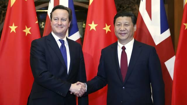 David Cameron (l) und Staats- und Parteichef Xi Jinping