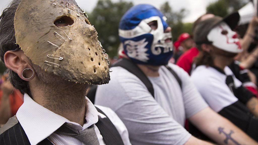 Maskierte Anhänger der Band Insane Clown Posse, die sogenannte «Juggalos», demonstrieren in Washington