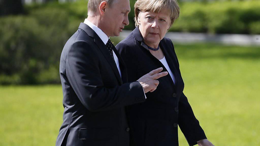 Der russische Präsident Wladimir Putin und die deutsche Kanzlerin Angela Merkel werden am Mittwoch in Berlin über die Ukraine-Krise diskutieren. (Archiv)