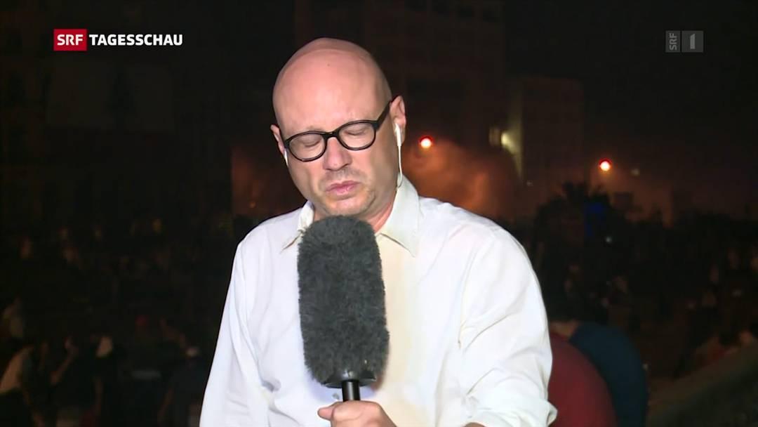 SRF-Korrespondent gerät während Livesendung ins Tränengas