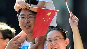 Könnte bald Zuwachs bekommen: Chinesische Familie in Peking. Reuters