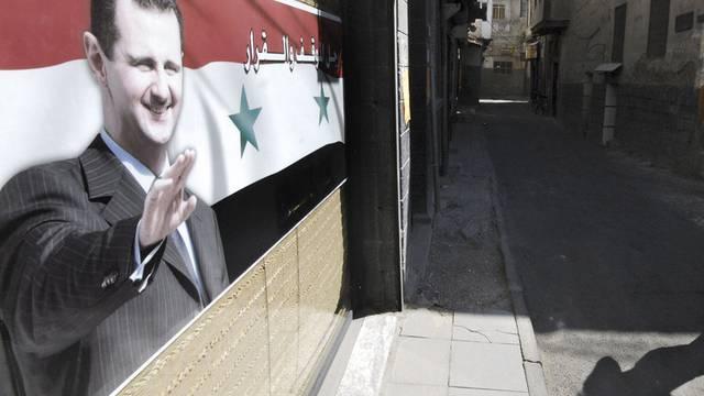Gasse in Damaskus mit Porträt von Präsident Baschar al-Assad (Symbolbild)