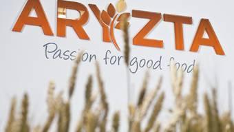 Weizenähren vor dem Logo des Backwarenherstellers Aryzta (Archiv)