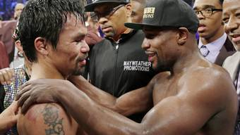 Floyd Mayweather (rechts) will nochmals gegen Manny Pacquiao boxen