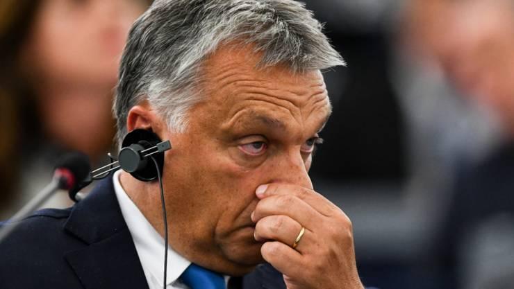 Steht wegen des eingeleiteten EU-Rechtsstaatsverfahrens in seinem eigenen Land in der Kritik: Ungarns Premierminister Viktor Orban. (Archivbild)