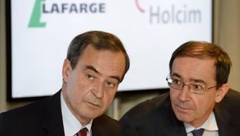 Dürfen Anteile verkaufen: Die CEOs von Lafarge und Holcim (Archiv)
