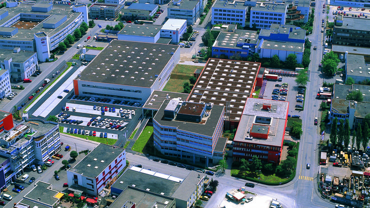 Das orange Gebäude Ecke Kägenstrasse/Christoph-Merian-Ring (unten rechts) wird ersetzt, ein zweites Gebäude wird auf dem dahinter liegenden Parkplatz errichtet.