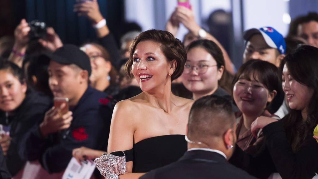 ARCHIV - Die US-Schauspielerin Maggie Gyllenhaal wird - wie die österreichische Regisseurin Jessica Hausner - der Jury des Filmfestivals in Cannes angehören. Foto: Nathan Denette/The Canadian Press/AP/dpa