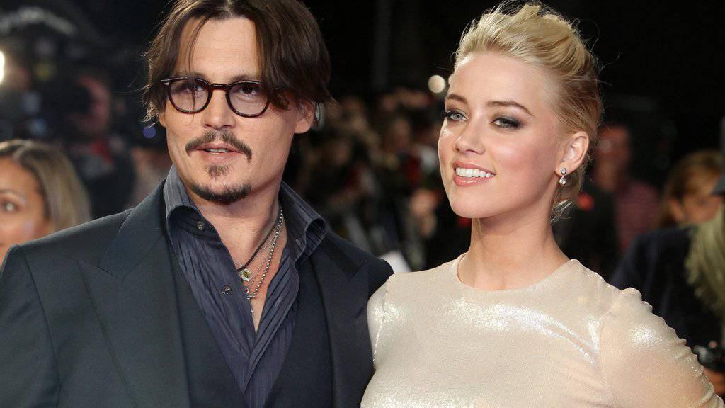 Die Abfindung nach der Trennung von Johnny Depp (links) will Amber Heard (rechts) für gute Zwecke spenden (Archiv)