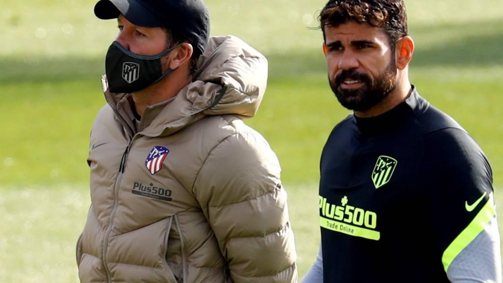 Diego Costa (rechts) und Trainer Diego Simeone haben nicht mehr das gleiche Ziel im Blick