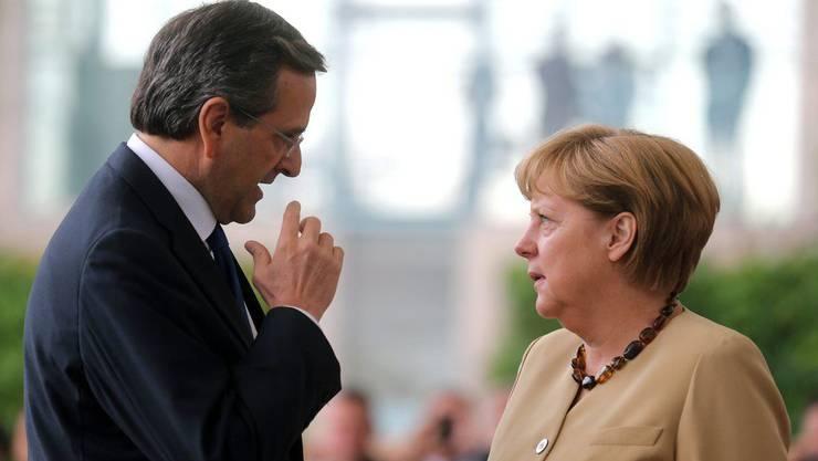 Bitte, bitte: Premier Antonis Samaras bei Angela Merkel. Der Grieche kommt als Bittsteller.