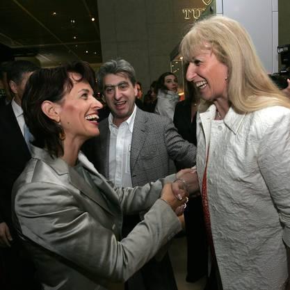 Nick Hayek grinst und Bundesrätin Doris Leuthard lacht (2008)