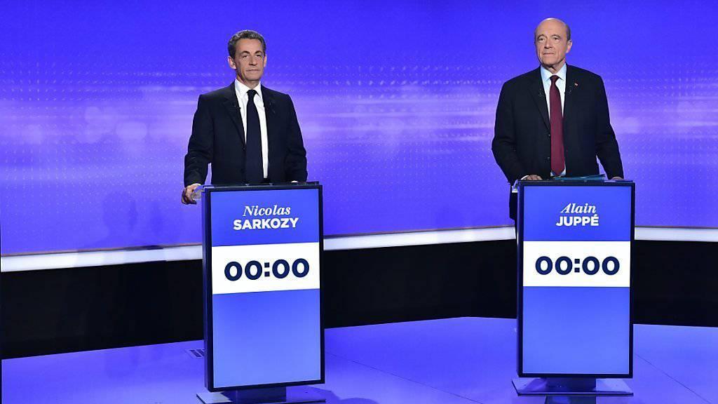 Sie sind die Favoriten für die Präsidentschaftskandidatur bei den französischen Republikanern: Ex-Regierungschef Alain Juppé (rechts) und Ex-Präsident Nicolas Sarkozy.