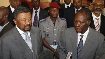 AU-Präsident Jean Ping (l.) und der international anerkannte Wahlsieger Alassane Ouattara