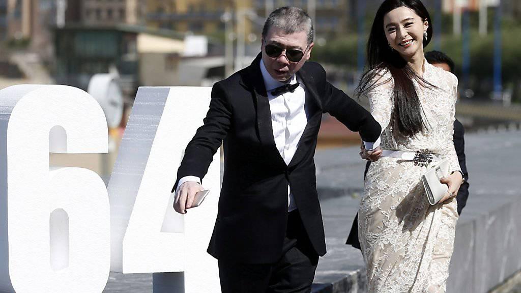 Regisseur Feng Xiaogang mit der Schauspielerin Fan Bingbing in San Sebastian