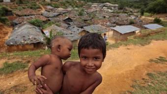 Viele Menschen mussten fliehen - wie auch das Mädchen der Rohingya in Burma
