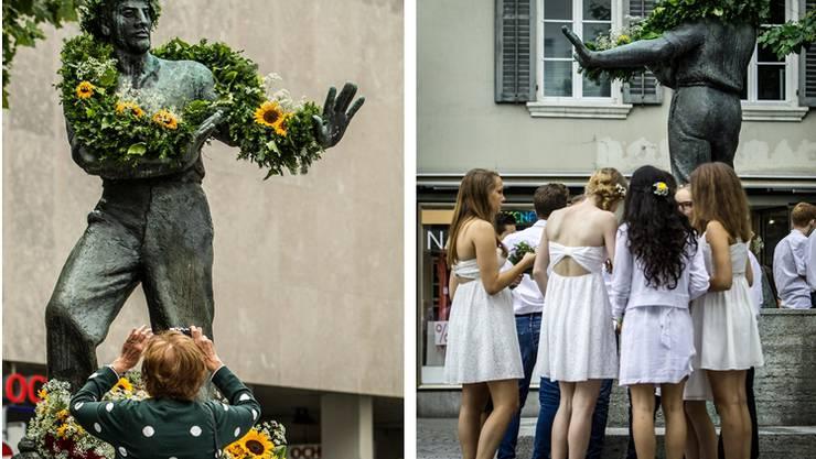 Am Maienzugmorgen schwirren aufgeregte Schülerinnen um das Wehrmänner-Denkmal.