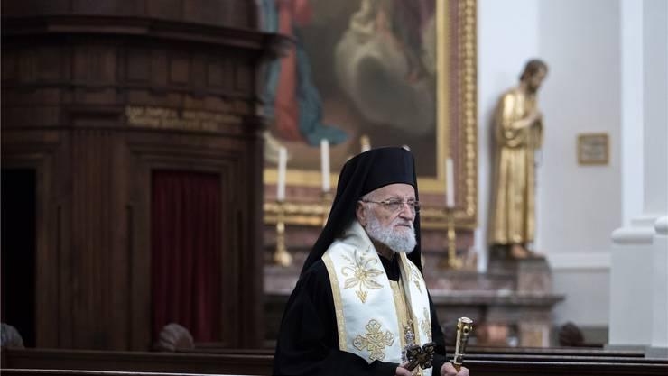 Patriarch Gregorios III., am Sonntagmorgen beim Gottesdienst-Einzug in die St.-Ursen-Kathedrale.