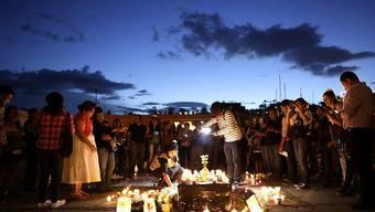 Menschen gedenken in Oaxaca im Mexiko des ermordeten Fotografen Ruben Espinosa (Archivbild)