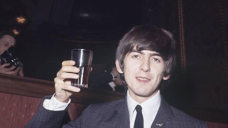 """George Harrison war zu Lebzeiten Gitarrist der """"Beatles"""". Ein unveröffentlichter Song von ihm wird nun versteigert. (Archivbild)"""
