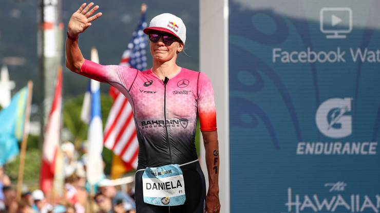 epa07916571 Daniela Ryf of Switzerland waves to fans after crossing the finish line of the 2019 Ironman World Championship Triathlon in Kailua-Kona, Hawaii, USA, 12 October 2019. EPA/DARRYL OUMI