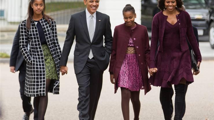 Sonntags auf dem Weg in die Kirche: Präsident Barack Obama mit Ehefrau Michelle und den Töchtern Malia, links, und Sasha (2013). Manuel Balce Ceneta/AP/Keystone