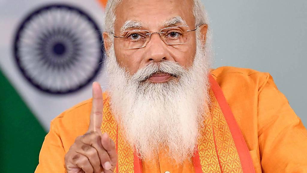 ARCHIV - Der indische Premierminister Narendra Modi hält anlässlich des Internationalen Yogatages eine Rede per Videokonferenz. Modi wird am 17. September 71 Jahre alt und seine hindunationalistische Partei veranstaltet für ihn drei Wochen lang Geburtstagsfeierlichkeiten. Foto: -/Indian government via PTI/dpa