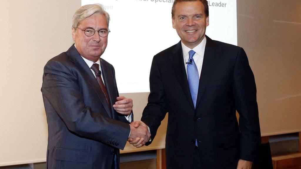 Mit einem opponierenden Investor konfrontiert: Hariolf Kottmann, Konzernchef von Clariant (links) und Peter Huntsman, Präsident und Konzernchef von Huntsman.