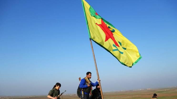 Mitglieder der Kurdenmiliz YPG feiern ihren Sieg über den «Islamischen Staat» in Kobane. Die YPG ist der militärische Arm der PYD.