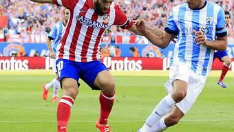 Atleticos Arda Turan (l) gegen Vigos Weligton Robson (r)