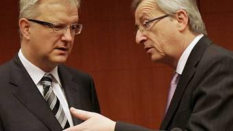 EU-Währungskommissar Rehn (r.) und EU-Gruppenchef Juncker