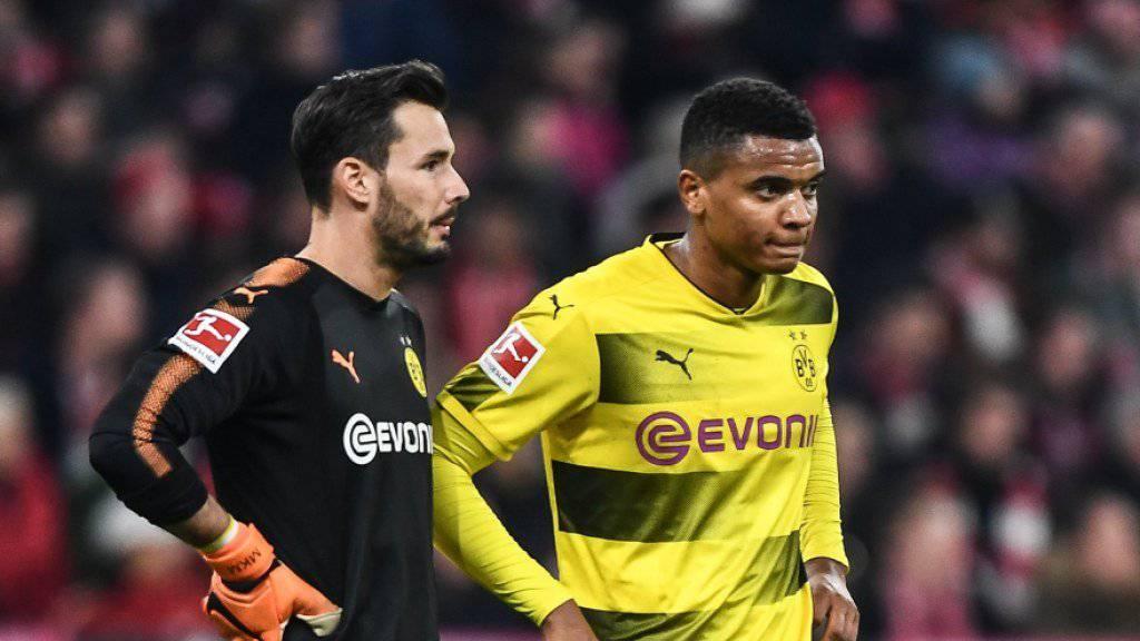 Die zwei Schweizer Roman Bürki und Manuel Akanji sind nach der Niederlage gegen Bayern München bedient