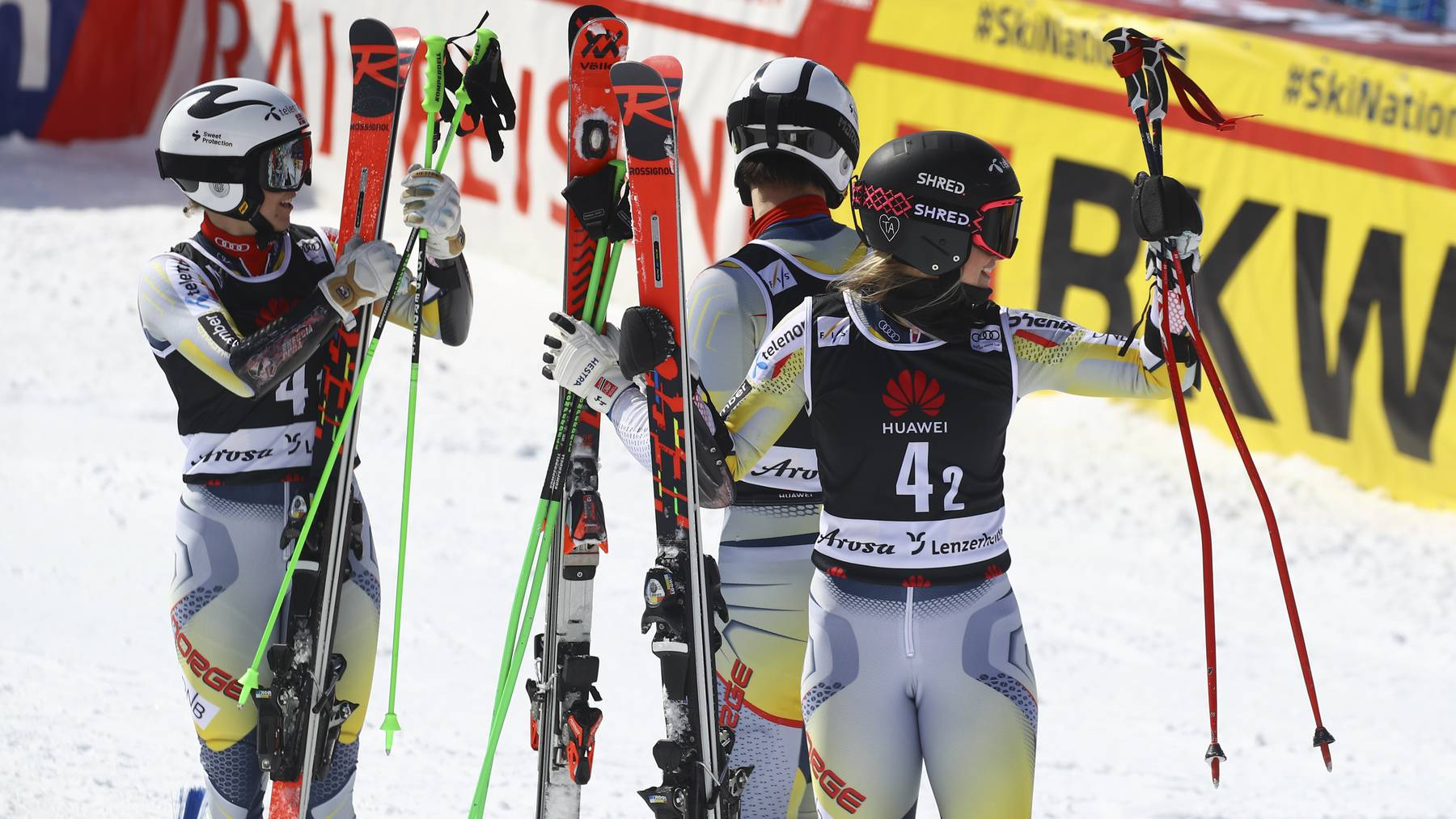 Norway's Kristina Riis Johannessen, right, and Norway team celebrate during an alpine ski, mixed World Cup team parallel event, in Lenzerheide, Switzerland, Friday, March 19, 2021.