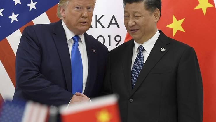 Die USA und China haben sich auf Details eines Teil-Handelsabkommens verständigt und damit die nächste Runde an geplanten Strafzöllen vorerst abgewendet.