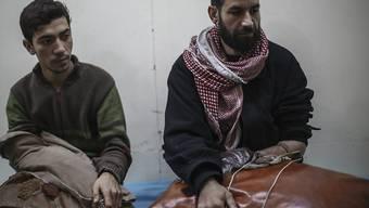 Verletzte Syrer in der Nähe von Damaskus.