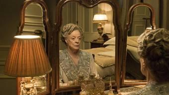 """Herrlich nostalgisch: Maggie Smith in der TV-Serie """"Downtown Abbey"""". Nun kommt die Geschichte mit weitgehend derselben Crew auf die grosse Leinwand. (zVg)"""