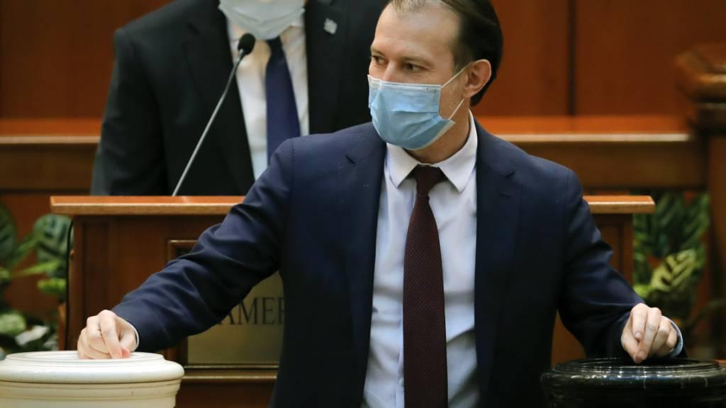 Florin Citu von der bürgerlichen Partei PNL ist neuer Ministerpräsident Rumäniens. Foto: Vadim Ghirda/AP/dpa