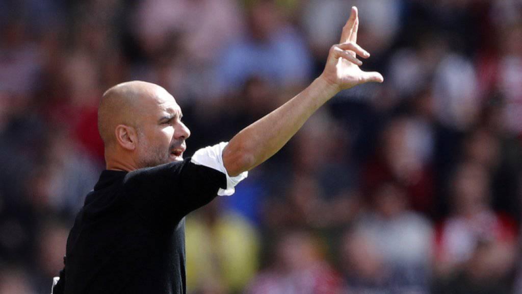Dirigiert weitere drei Jahre das Team von Manchester City: Coach Pep Guardiola.