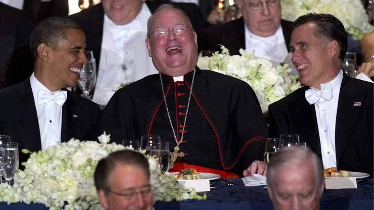 Obama und Romney haben ihren Spass mit dem Erzbischof