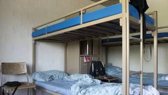 Betten in einem Empfangs- und Verfahrenszentrum für Asylbewerber (Archiv)