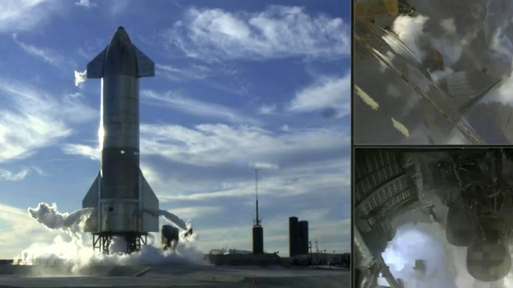 HANDOUT - Dieses Videostandbild, das auf der Twitter-Seite von SpaceX gepostet wurde, zeigt die Rakete «Starship» der Raumfahrt-Firma SpaceX kurz nach dem Abbruch eines Tests. Nur 1,3 Sekunden vor dem Start hat ein Problem mit dem Triebwerk zum Abbruch eines Tests der neuen Rakete geführt. Foto: Uncredited/SpaceX/AP/dpa - ACHTUNG: Nur zur redaktionellen Verwendung im Zusammenhang mit der aktuellen Berichterstattung und nur mit vollständiger Nennung des vorstehenden Credits