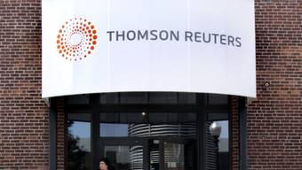 Der Daten- und Nachrichenanbieter Thomson Reuters unterzieht sich einer Rosskur: 3'200 Stellen werden gestrichen. (Archiv)