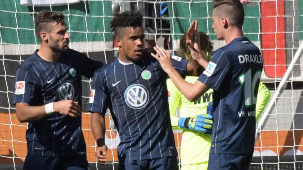 Setzten sich mit Wolfsburg in Augsburg durch: Daniel Caligiuri (links), Torschütze Daniel Didavi (Mitte) und Julian Draxler